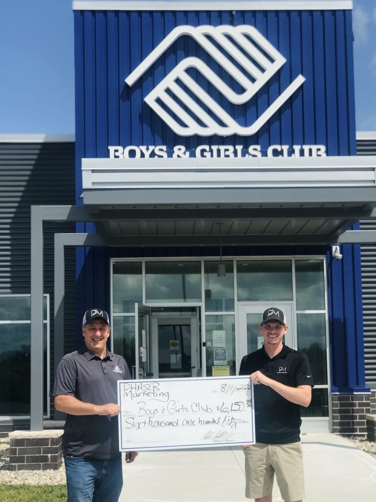 Luke and Pat holding the check from the Phaser Fundraiser