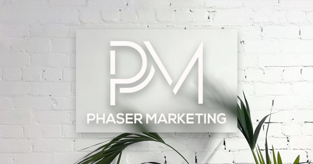 Phaser Marketing Logo on a white brick wall